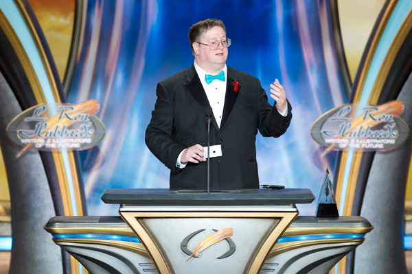 Martin L. Shoemaker on stage accepting his award