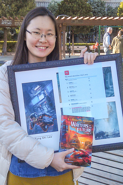 Jessica with her illustration for Writers of the Future Vol 31 and bestseller list