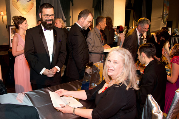 Sharon signing a copy of her award-winning story for William Pomerantz, VP Special Projects at Virgin Galactic