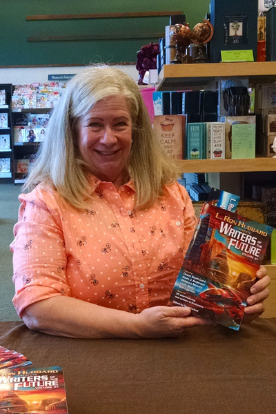 Sharon Joss at a book store with copies of Writers of the Future Vol 31