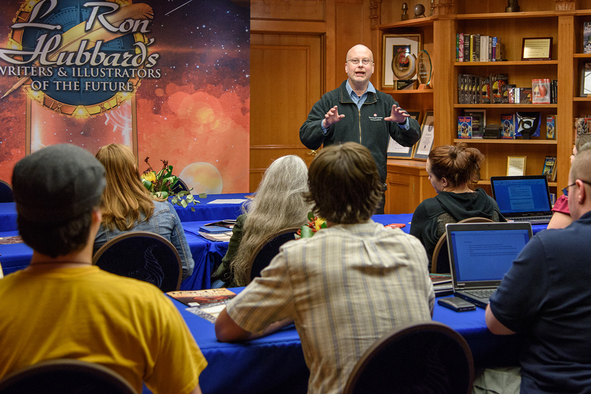 Robert J. Sawyer giving a helping hand at the workshop to winners of the Writers of the Future Contest.