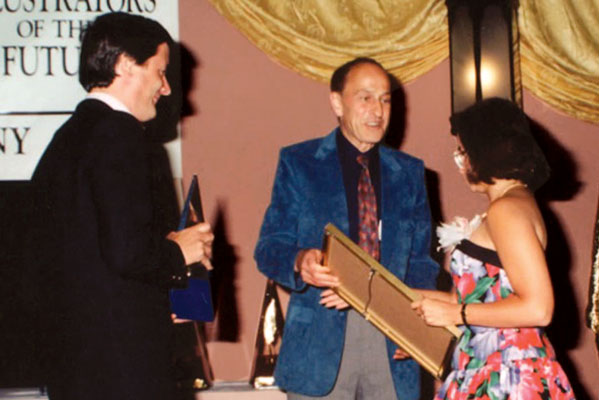 Tim Powers and Roger Zelazny present First Place trophy and certificate to Valerie J. Freireich.