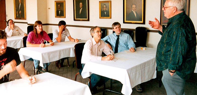 Algis Budrys leads the Writers Workshop.