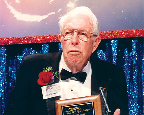 Jack Williamson is presented with a plaque for his service as a judge over the first ten years of the Contest; all of the remaining original judges also receive plaques.