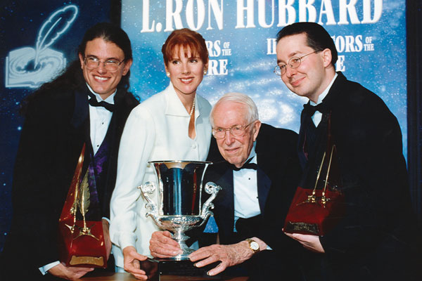 Patricia Tallman and Jack Williamson flanked by Writer Gold Award winner Brian Wightman (left) and Illustrator Gold Award winner Paul Marquis.