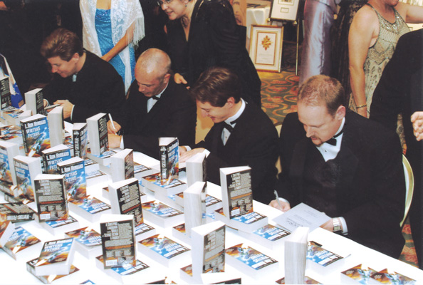 Writer winners autograph copies of the anthology at the reception immediately following the event.