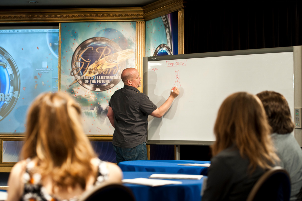 Instruction in action: Cliff goes to the white board.