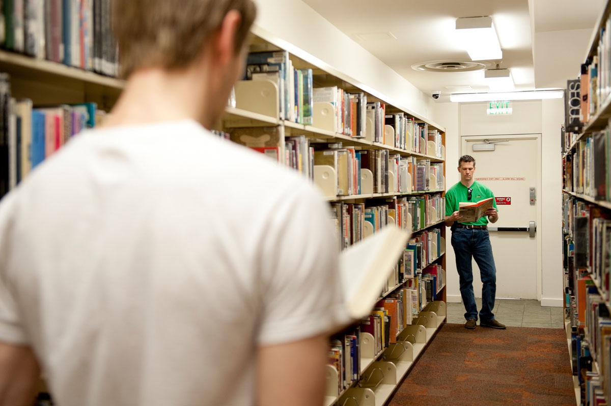 C Stuart Hardwick in library