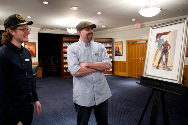 Alex Brock (left) with Daniel (right) admiring his artwork