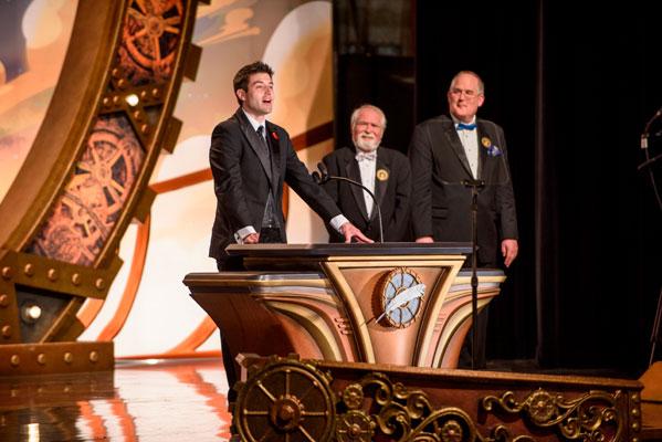 Illustrator winner Preston Stone onstage with judges Larry Elmore and Todd McCaffrey.