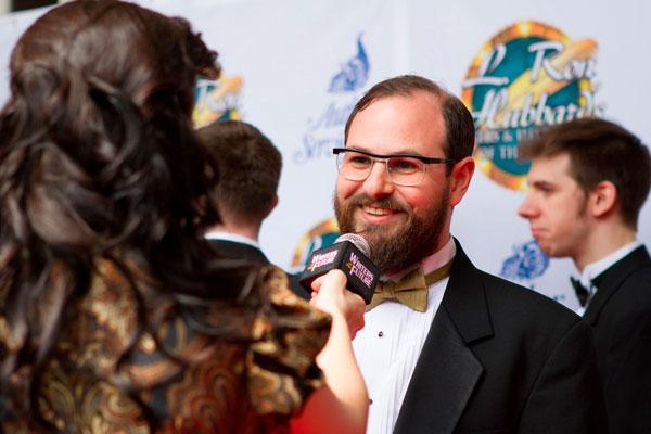 Writer winner Jon Lasser being interviewed on the red carpet.