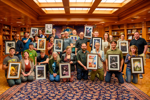 Artists and authors together with their artwork for each of the stories.