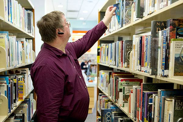 Martin Shoemaker finding the perfect book for his research at the LA Public Library.