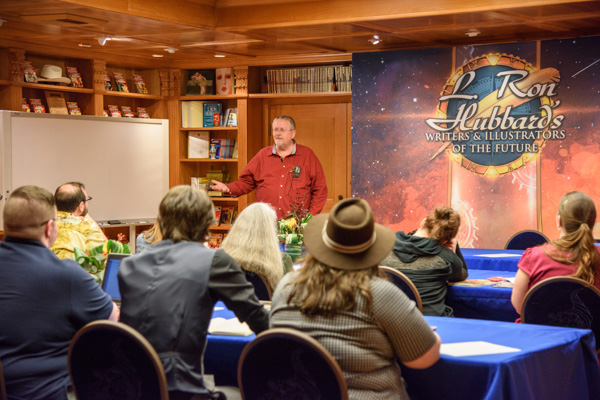 Orson Scott Card talking to the writer winners.