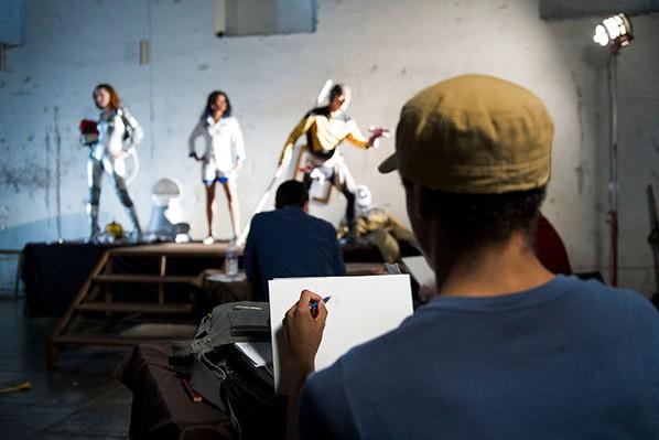 Taylor Payton sketching at Illustrator Judge Cliff Nielsen's studio