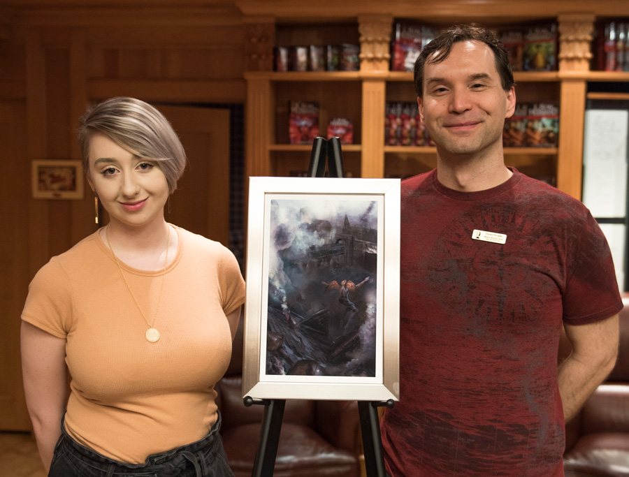 Artist Alana Fletcher with Eneasz and the artwork for his story