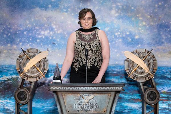 Jennifer giving acceptance speech.