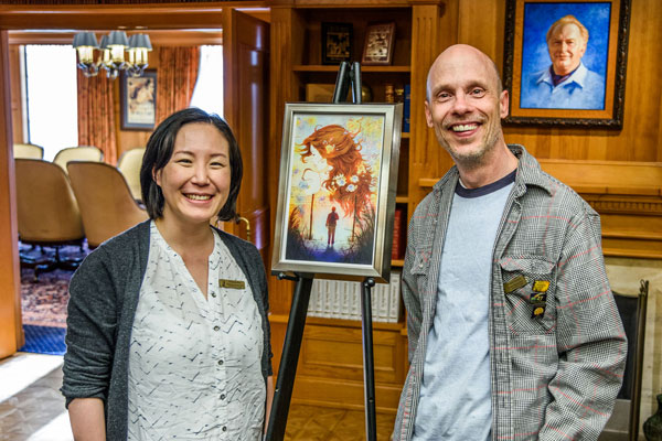 Preston with Illustrator Christine Rhee seeing his story art for the first time