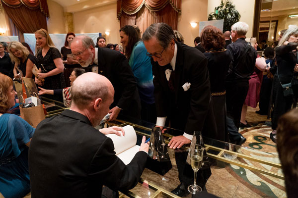 Tim Powers getting book signed by Preston Dennett