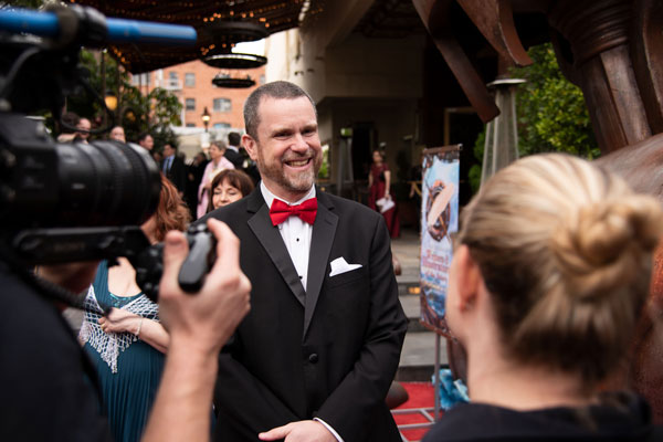 John Haas on red carpet at Writers of the Future gala
