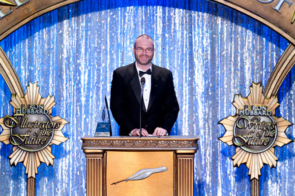 Jason Fischer at the 26th Annual Awards Ceremony accepting his award